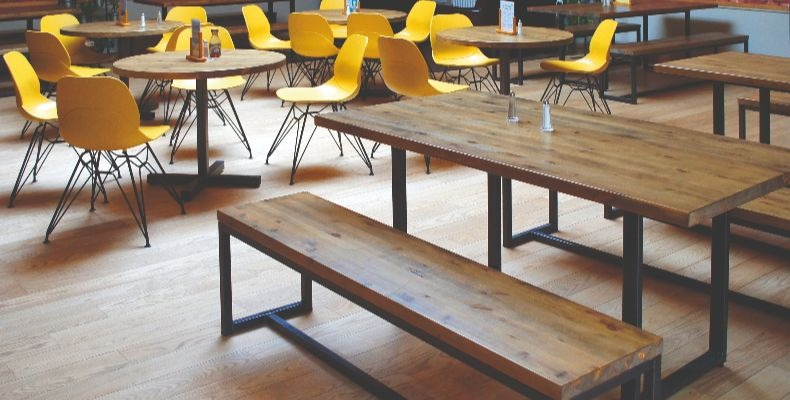 Rugged character tops and industrial-style frames were specified to create an 'urban' feel at Cambridge Sixth Form Centre