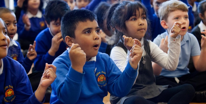 Sharing and enjoying singing together has a positive impact on cohesion within the school community