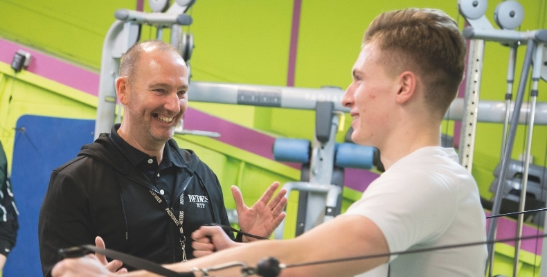 Strength and conditioning coach Tony Morriss with a student in the gym