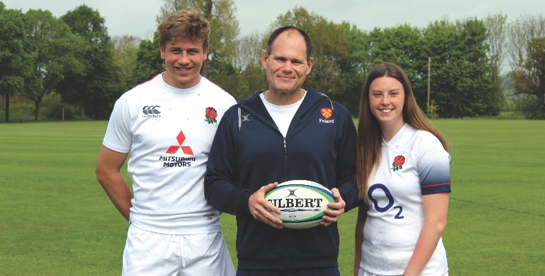 Andrew Le Chevalier (centre) with former upper sixth students Ollie Stonham and Ellie Lennon