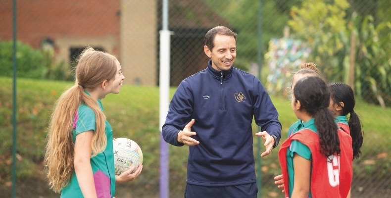 Daniel Emery with pupils during a PE lesson