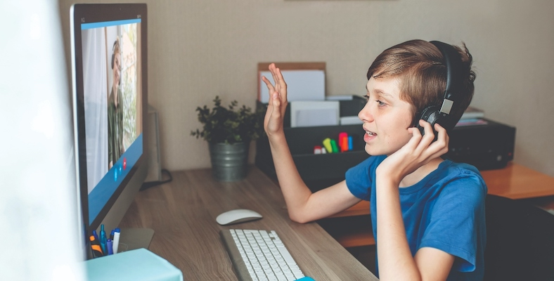 teenage-boy-communicates-with-relatives-via-web-camera-video-conference-computer-home
