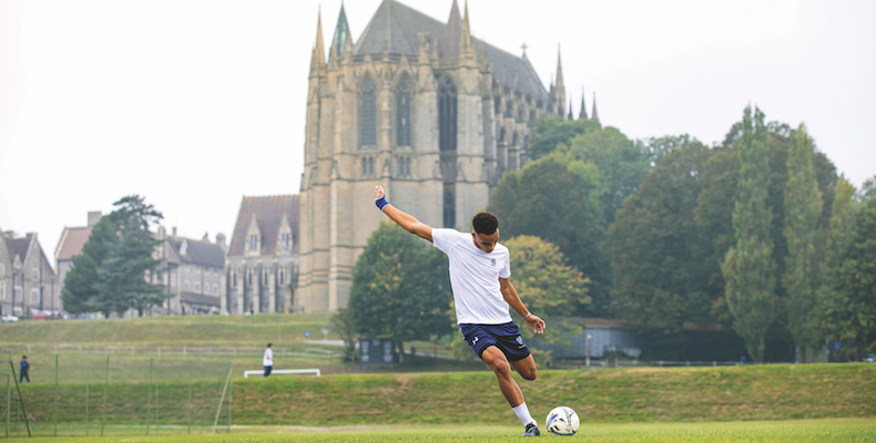 A pupil playing football at Lancing College in Sussex